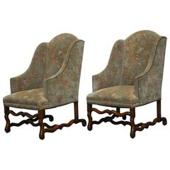 Pair of Walnut Os De Mouton Upholstered Wingback Chairs