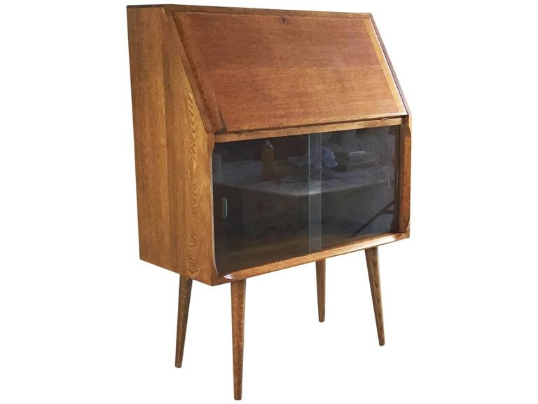 1950s solid oak bureau secretaire with storage area fronted with glass doors at 1stdibs. Black Bedroom Furniture Sets. Home Design Ideas