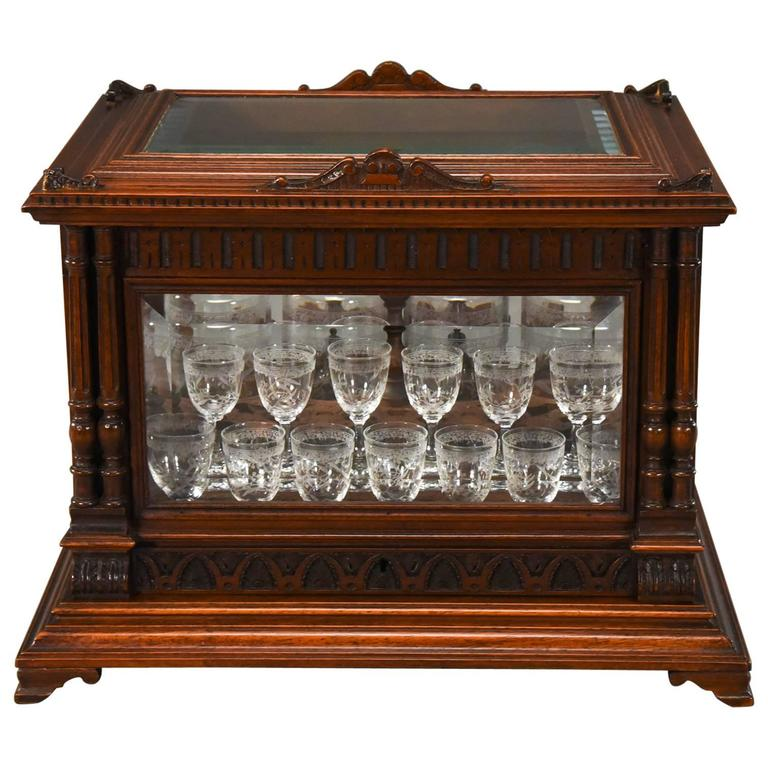 Exceptional Baccarat Cave à Liqueurs with Original Labels in Carved Oak Case