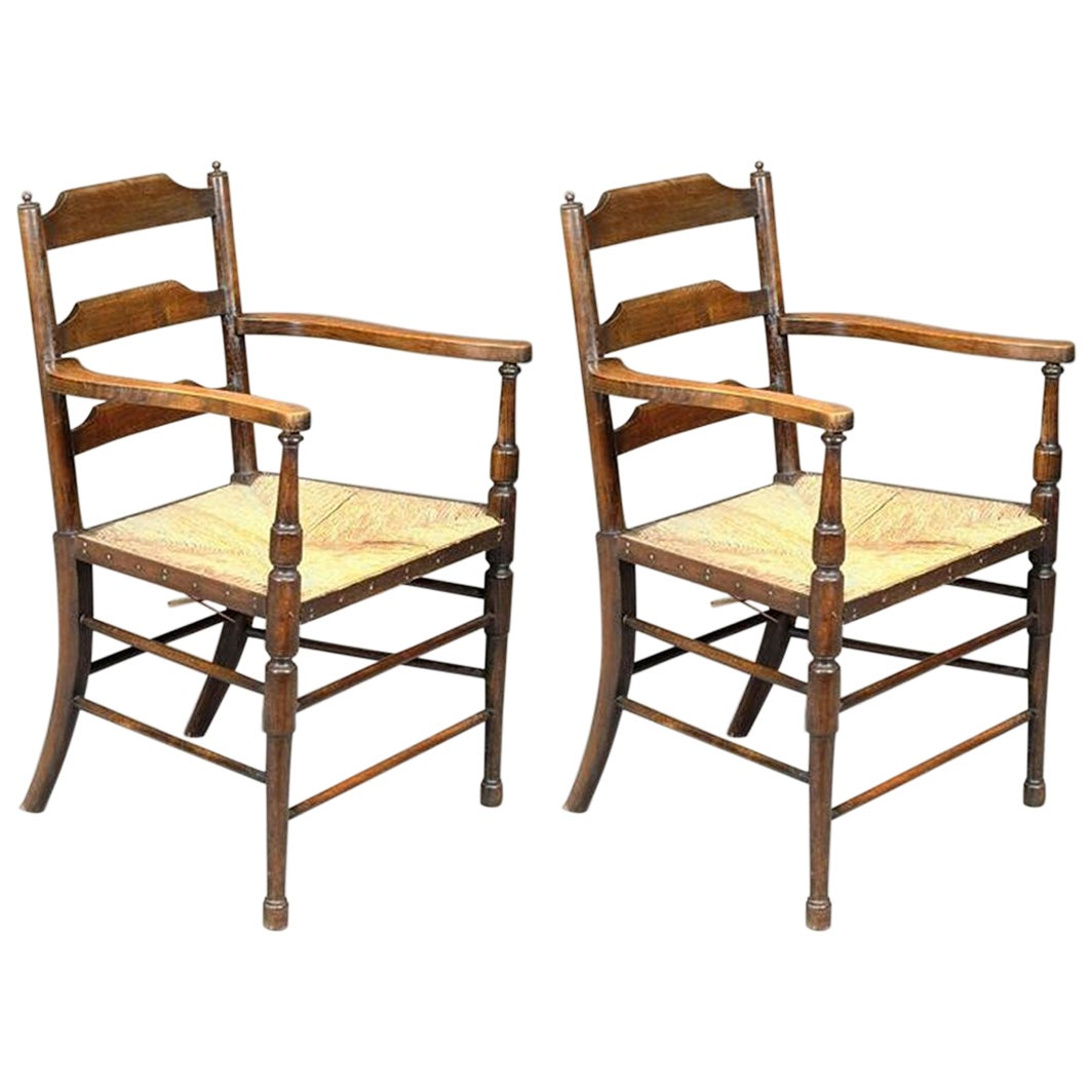 Morris and Co. A Rare Pair of Arts and Crafts Ladder Back Rush Seat Armchairs.