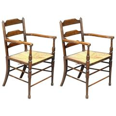 Morris and Co. A Rare Pair of Ash and Beech Ladder Back Armchairs.