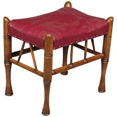 Liberty and Co. A Stained Beech and Leather Thebes Stool.