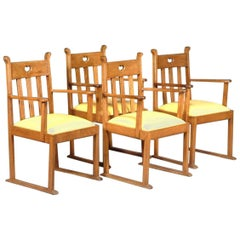 Four Oak Armchairs, in the style of Liberty & Co with heart Cut-Out to the backs