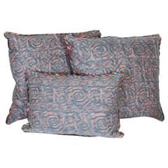 A Set of Three Fortuny Fabric Cushions in the Maori Pattern
