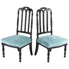 "Pair of Napoleon III Ebonized ""Chauffeuses"" Low Chairs, 1870s"
