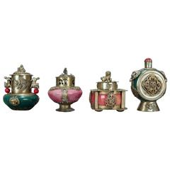 Four Antique Chinese Hard Stone Jeweled Scent Bottles with Silverwashed Copper