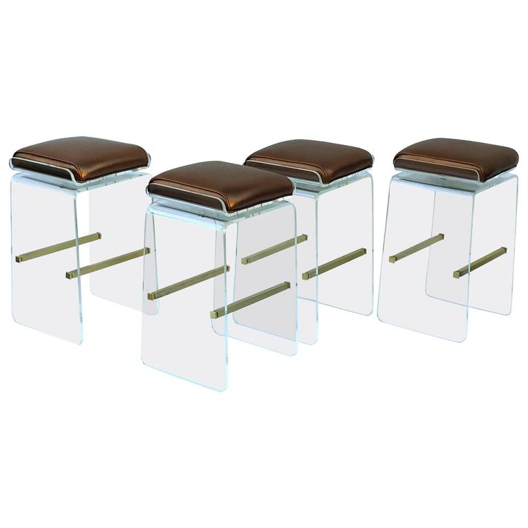 Set of Four Swivel Acrylic and Brushed Brass Barstools by Charles H. Jones