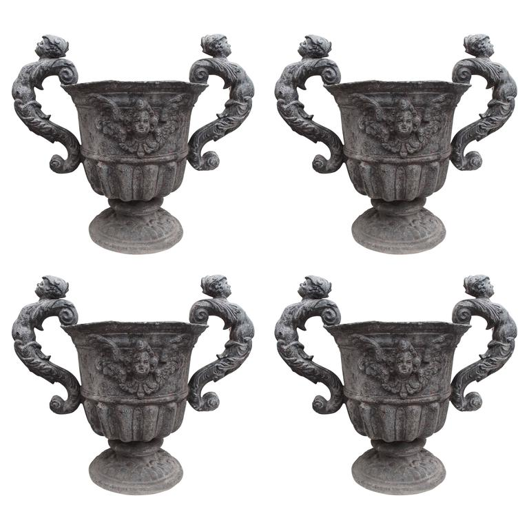 Set of Four Lead Urns with Cherubs 1