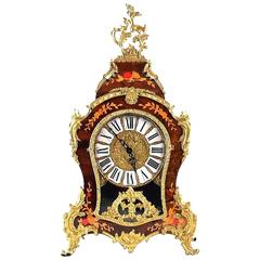 Fine French Gilt Bronze and Inlaid Clock with Enameled Numbers