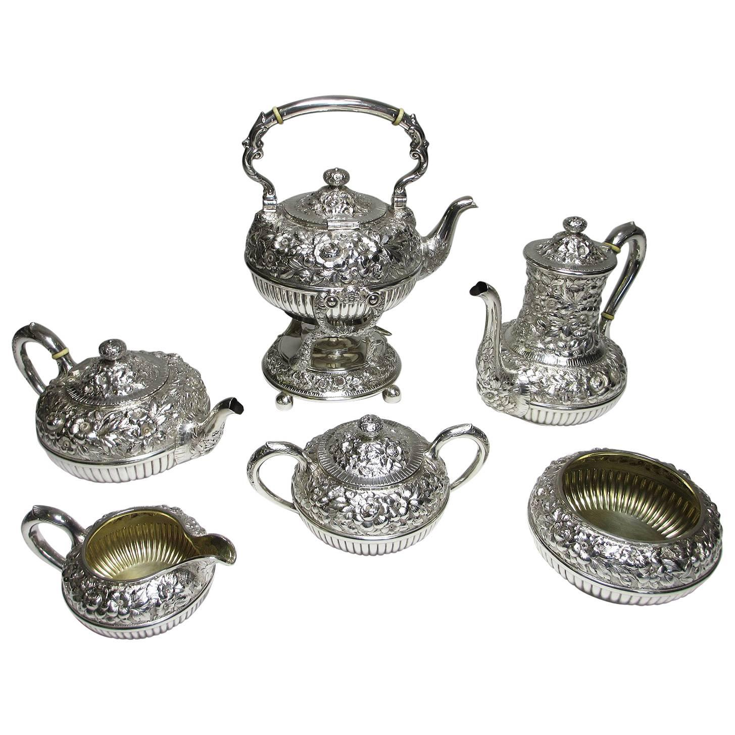 Geo C. Shreve & Co. a Finely Chased Six Piece Sterling Silver Tea and Coffee Set