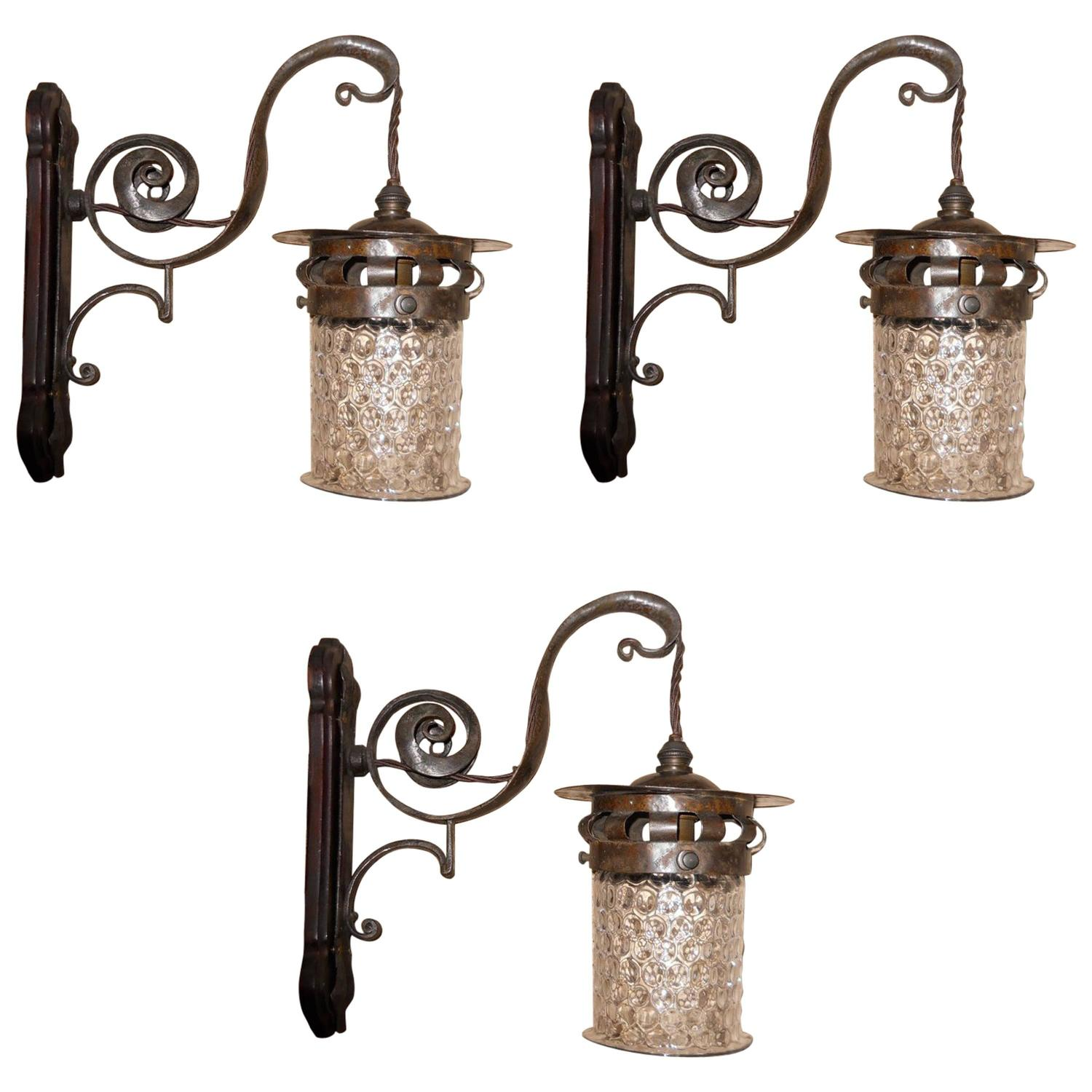 Three pairs of Arts and Crafts hand made iron wall lights with mottled shades For Sale at 1stdibs