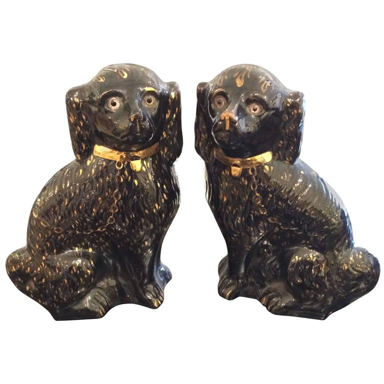 Large Pair of Antique Black and Gold Staffordshire Spaniels 1