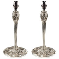 A Pair of Arts and Crafts Silver Plated Table Lamps With Stylised Floral Details