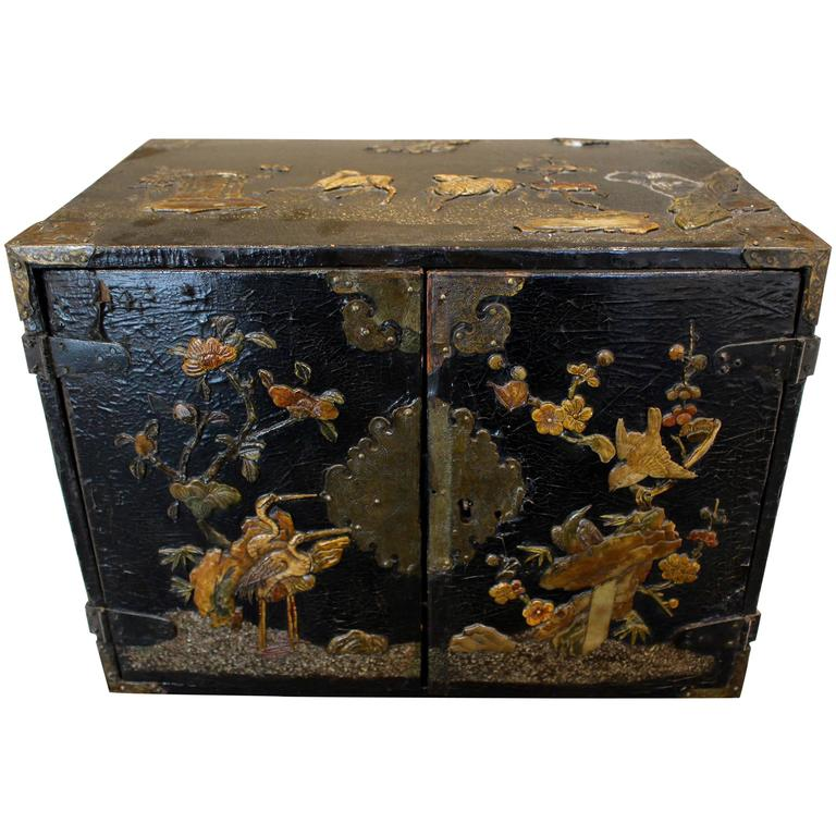 Small Chinese Black Lacquered Wood Cabinet with Raised Traditional Scenery For Sale