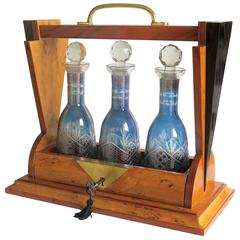French Art Deco Tantalus with Three Blue Cut Glass Engraved Decanters lockable