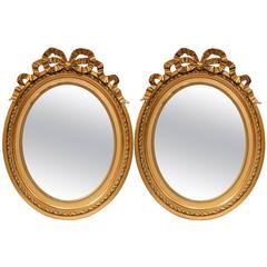 Pair of 19th Century French Louis XVI Oval Gilt Mirrors with Carved Ribbon Bow