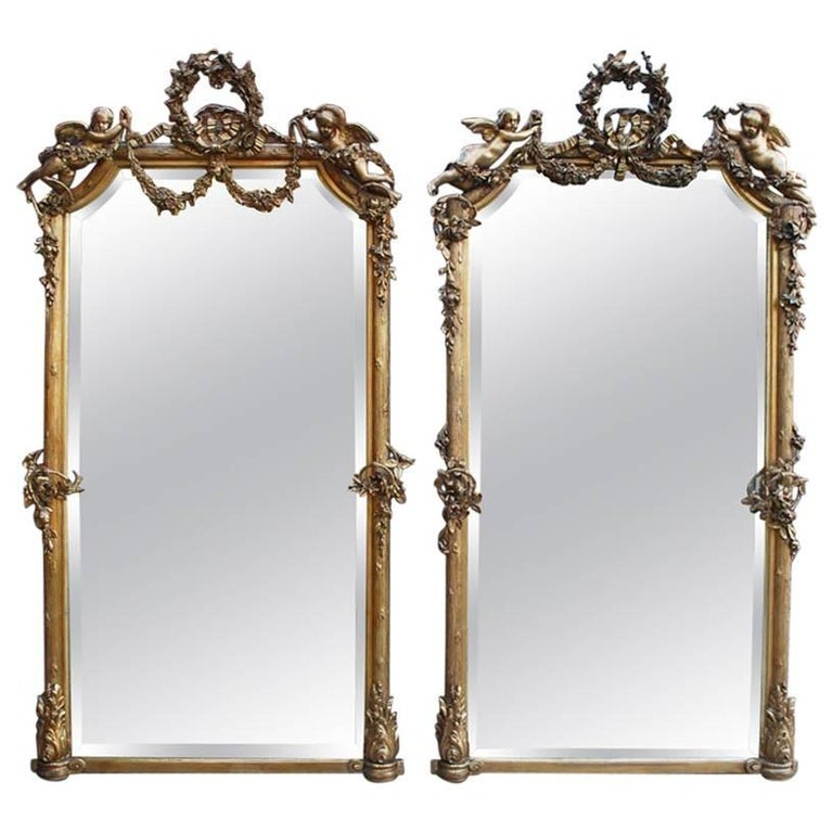 Monumental pair of large-scale antique French gilt golden mirrors For Sale