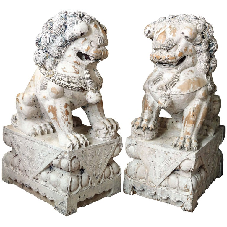 Pair of Carved Wood Painted Foo Dogs For Sale