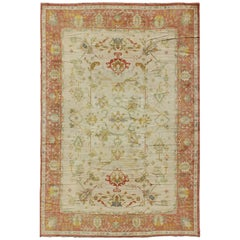 Antique Spanish Large Rug in Ivory Background, Green and Coral Border
