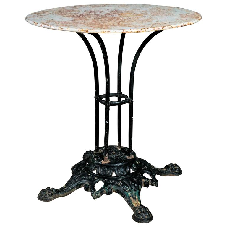 French Iron Bistro Table With Painted Top And Paw Foot Cast Base Circa 1890