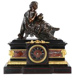 J.E. Caldwell Black Slate Mantel Clock under Bronze Sculpture of Cartographer