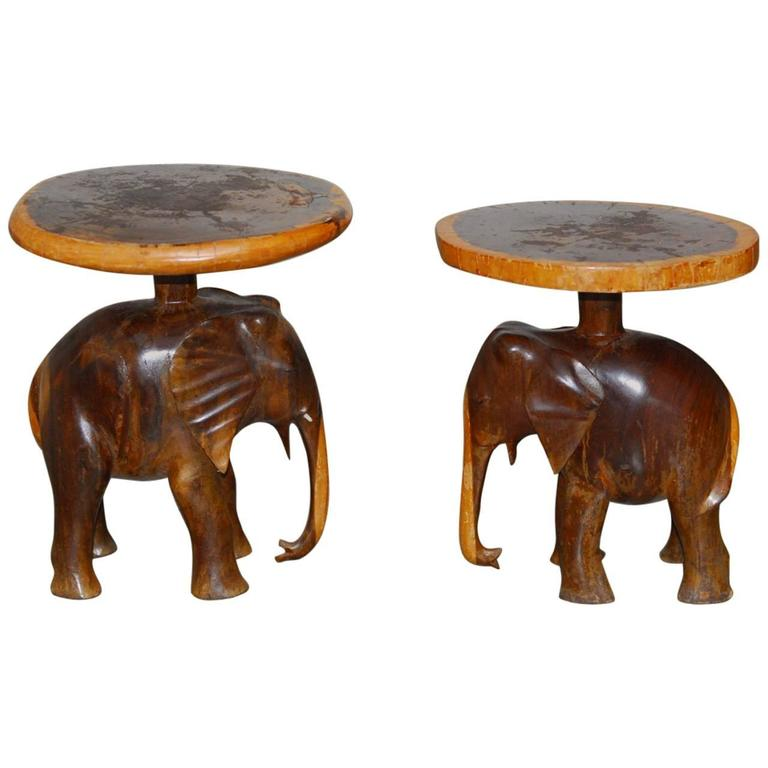 Pair of carved elephant drink tables or stools for sale at