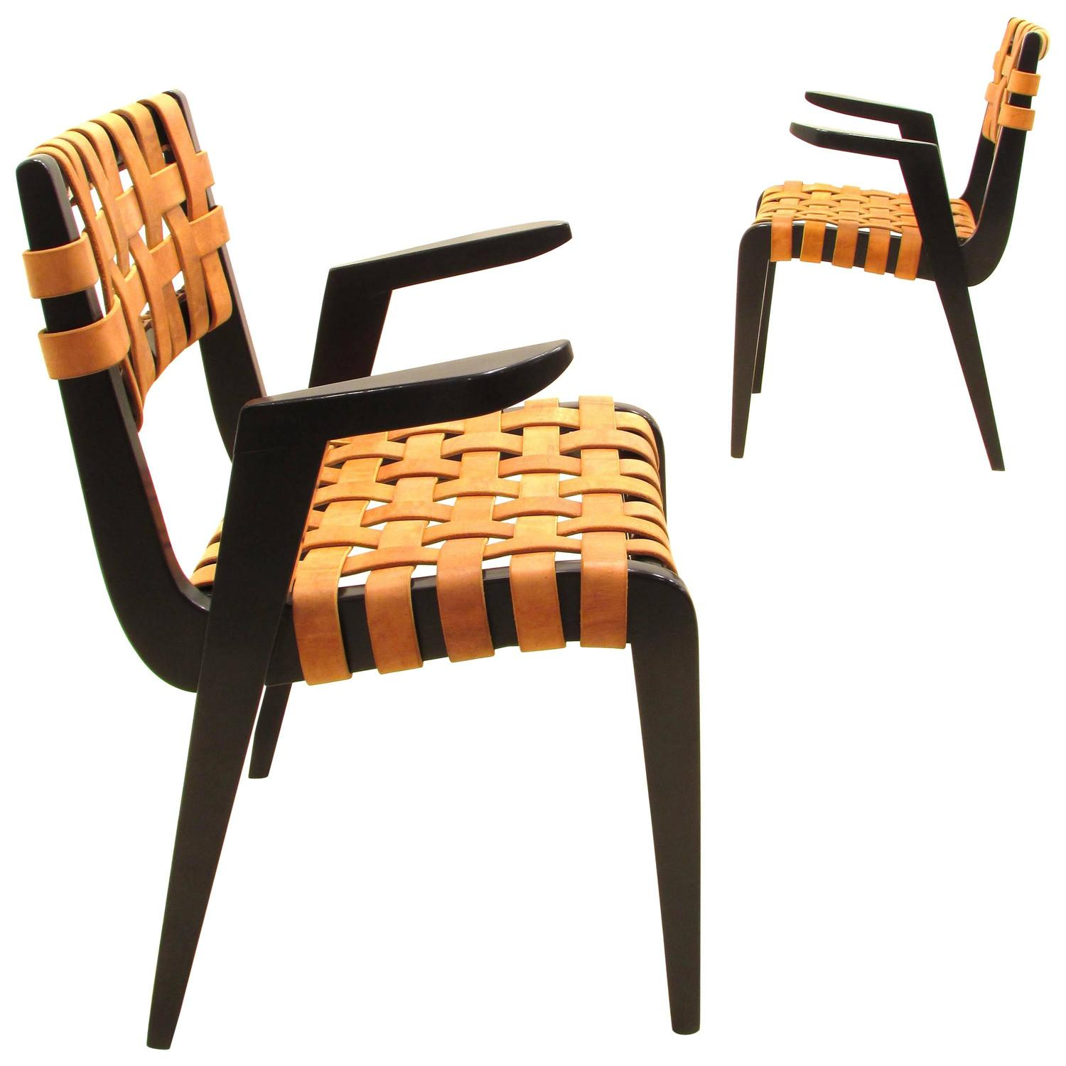pair of jens risom style black leather strap chairs at 1stdibs