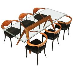 Impressive glass table with wooden base and six cowhorn chairs, Italy