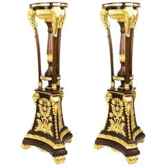 Pair of Mahogany Empire Style Giltwood Carved Torchers