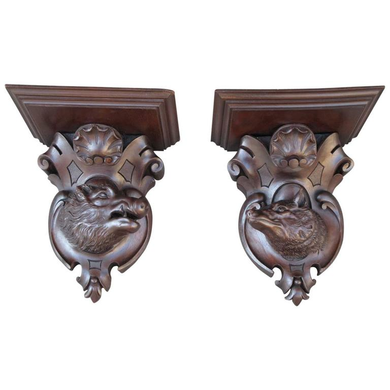 Pair of 19th Century German Black Forest Carved Walnut Wall Brackets