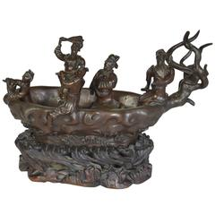 Cast Bronze Sculpture of Men in a Boat on a Carved Wooden Base, Signed