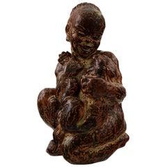 Royal Copenhagen Stoneware Figure of Black Boy with Cat