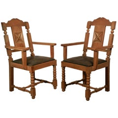 In the Style of Charles Dudouyt, two  Neo Rustique Oak Armchairs