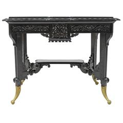 Aesthetic Movement Centre Table in Carved Ebonized Wood with Brass Feet, c. 1870