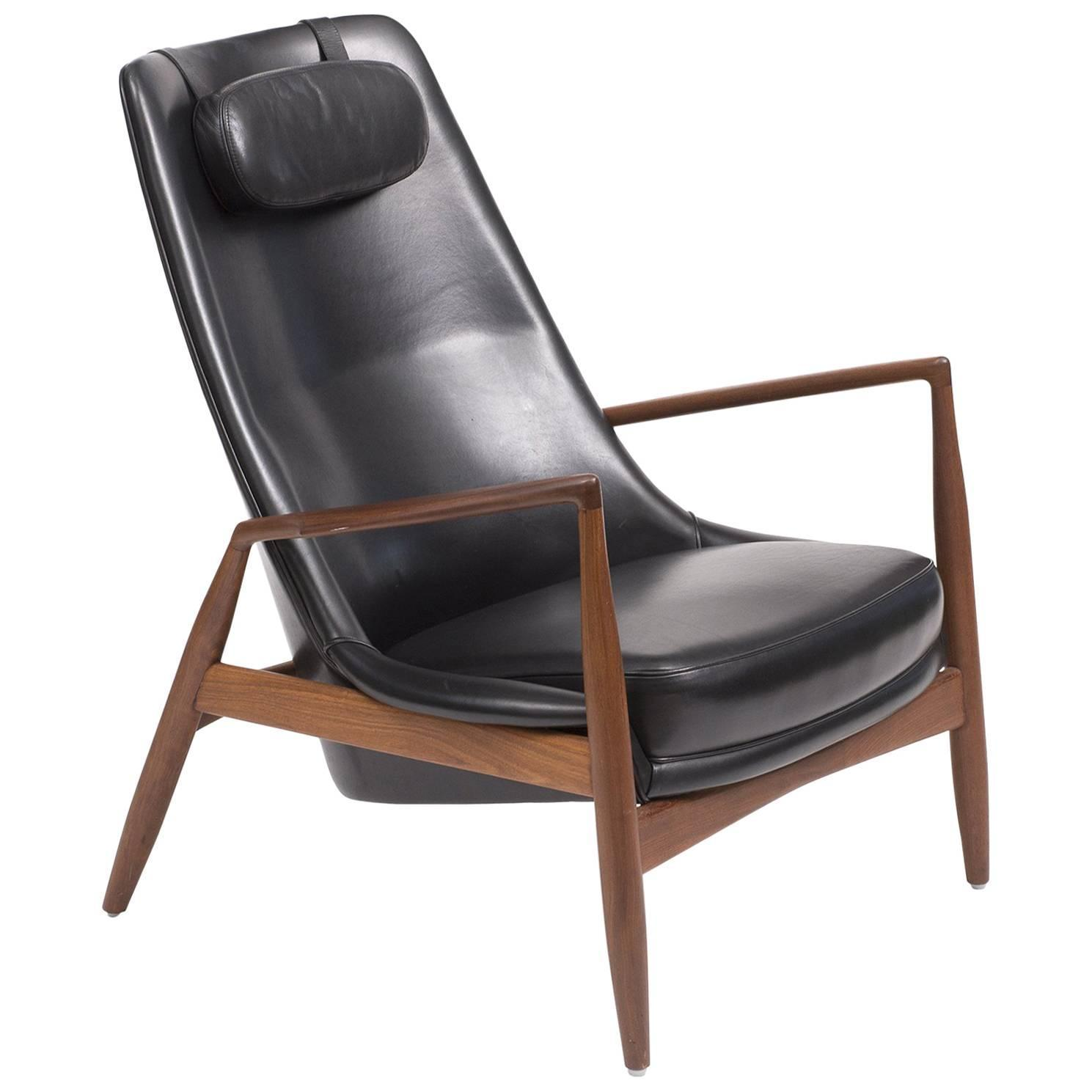 This sculptural pair of lounge chairs by ib kofod larsen is no longer - Ib Kofod Larsen High Back Seal Chair In Teak And Black Leather For Ope 1960s For Sale At 1stdibs