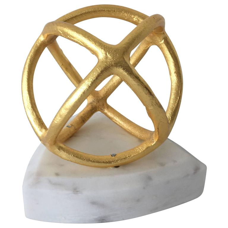 Modern gilt sphere object sculpture on white marble base for Modern decorative objects