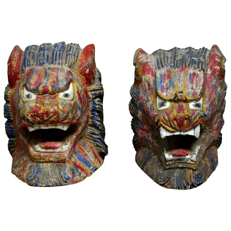Pair of Polychrome Foo Lion Roof Ornament Heads For Sale
