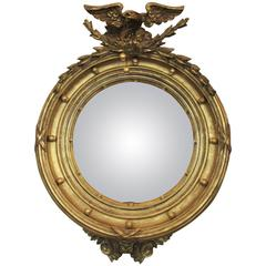 Early 19th Century English Regency Giltwood Convex Mirror with Eagle and Tassle