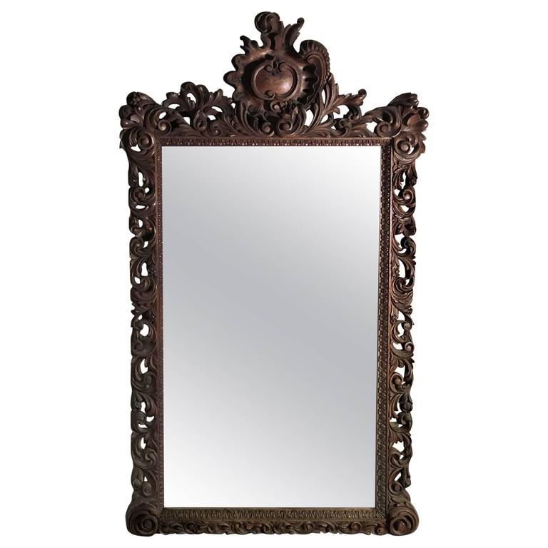 19th century black forest hand carved walnut mirror in the