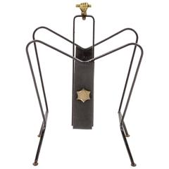Magazine Stand by Jacques Adnet