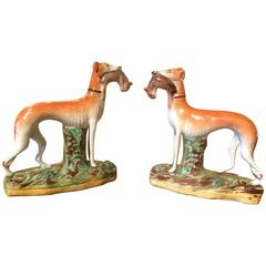 Pair of Straffordshire Greyhounds or Whippets with Rabbits