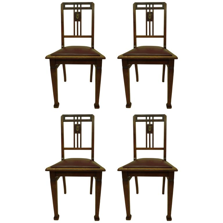 Four French Early Modern Dining Chairs with Inlaid Brass Grid Back For Sale