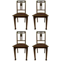 Four French Early Modern Dining Chairs with Inlaid Brass Grid Back
