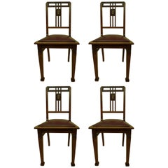 Four French Early Modernist Wood Dining Chairs with Inlaid Brass Grid Back