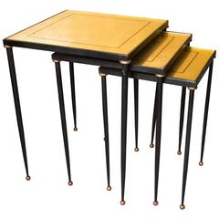 Set of Three Adnet Style Metal and Gilt Eglomisé Nesting Tables