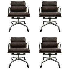 Four Herman Miller Eames Soft Pad Management Chairs