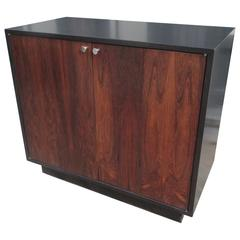 Harvey Probber Rosewood and Ebonized Wood Cabinet with Bifold Doors