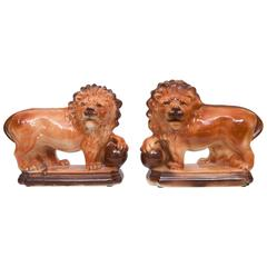 Pair of Ceramic and Glazed Lions by Lancaster & Sons (Hanley) Ltd (L&S)
