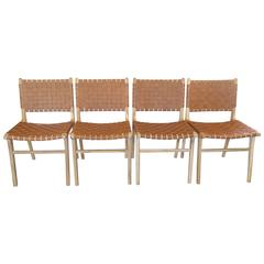 "Group of Four ""Flora"" Leather Strapped Dining Chairs"