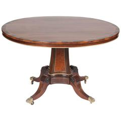A Rosewood, Burwood and Calamander Centre Table In The Manner of George Oakley